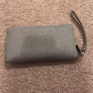 Gently used clutch/wallet in sparkly silver